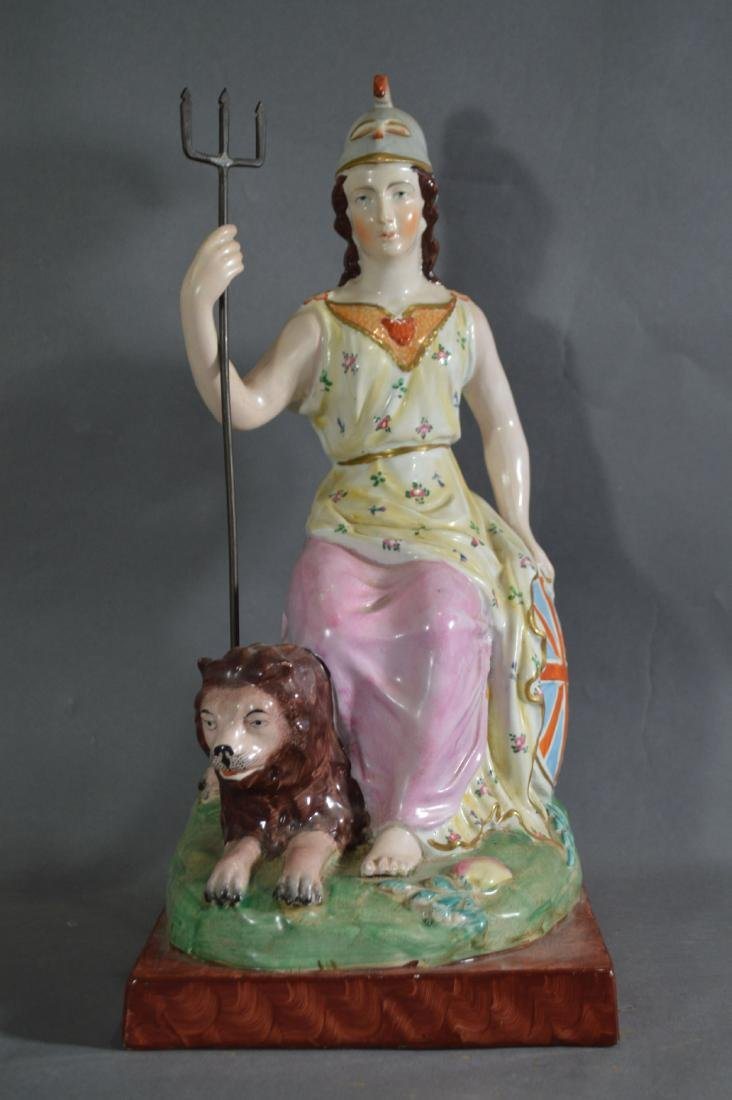 "PORCELAIN FIGURE OF ATHENA SEATED WITH LION. 14 1/2"" x"