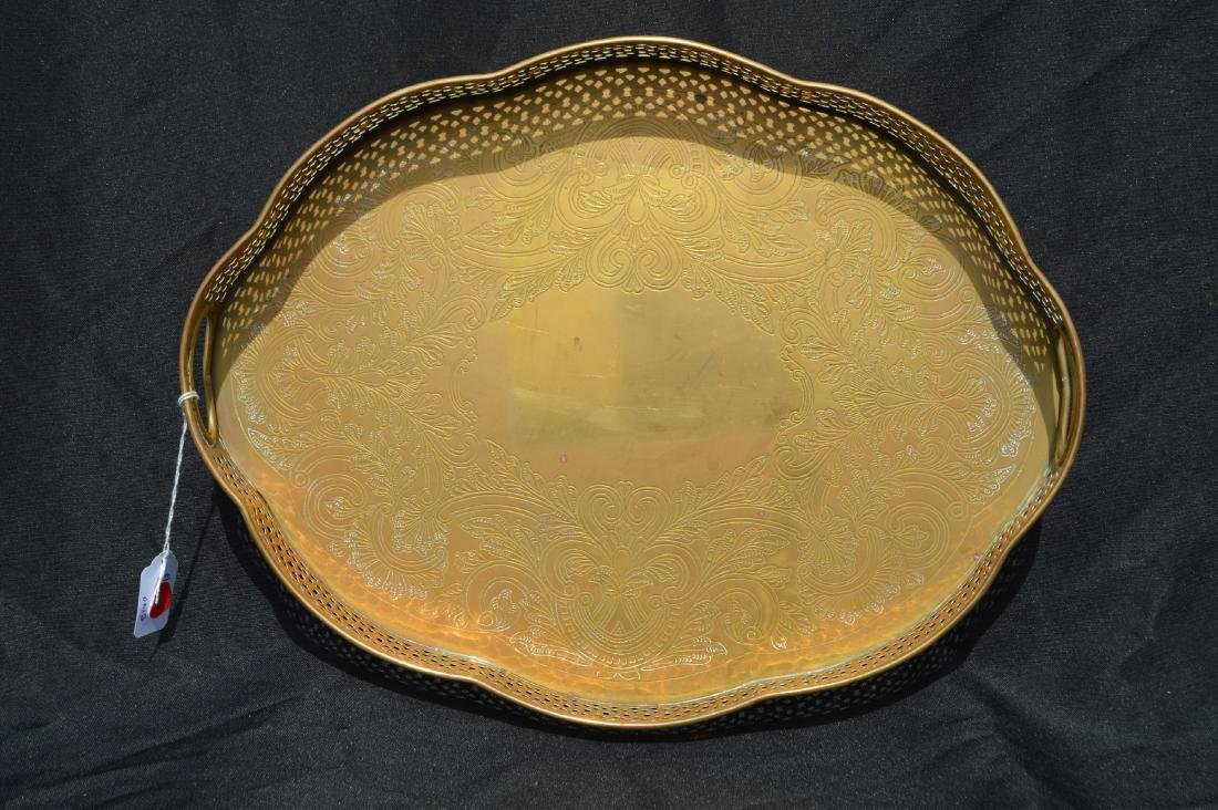 "2 LARGE VINTAGE BRASS SERVING TRAYS. 17"" AND SMALLER - 2"