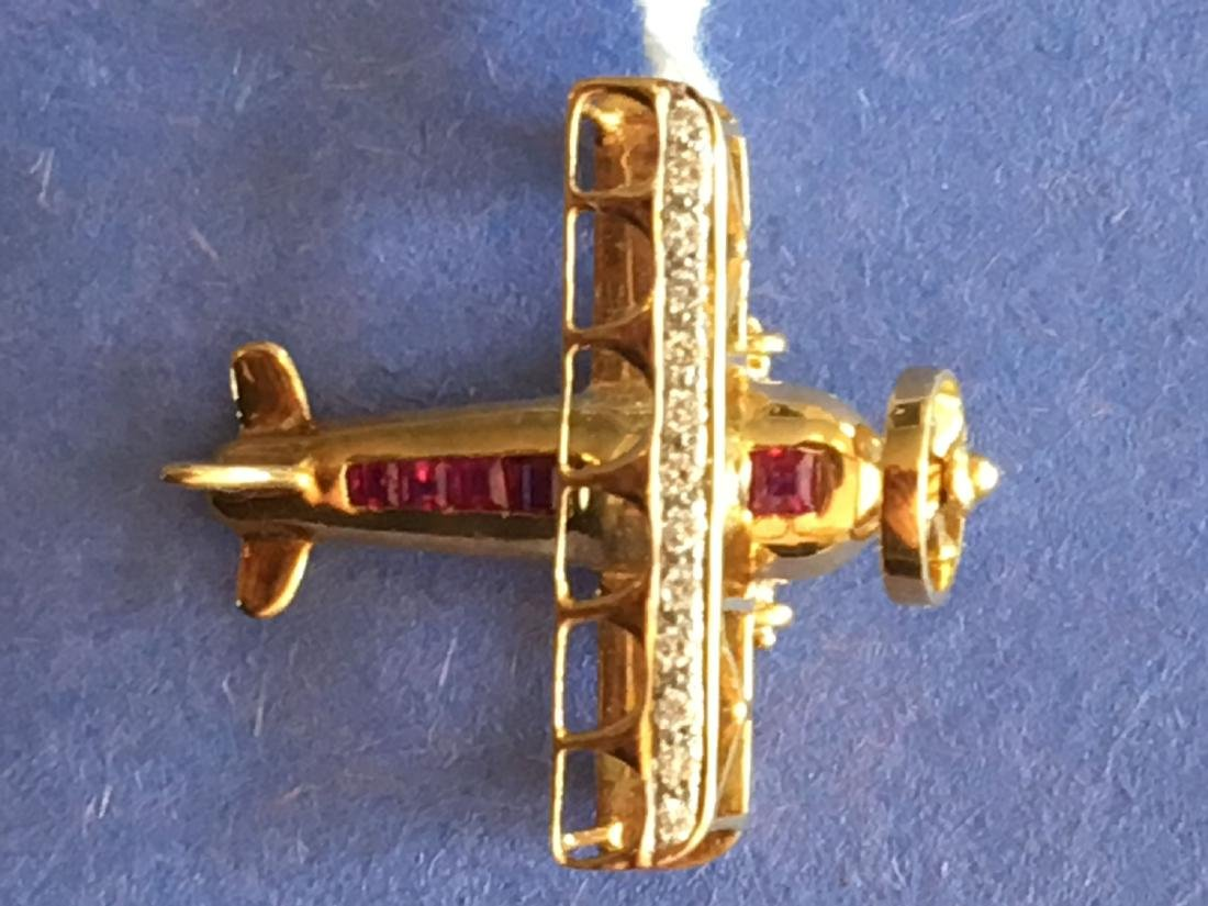 14K GOLD, DIAMOND AND RUBY PENDANT . 8 GRAMS