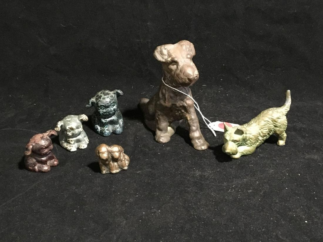 2 BRONZE SCOTTIE DOGS AND 4 PAINTED CAST IRON DOGS