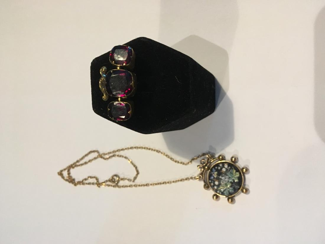 AN ENAMELED VICTORIAN GOLD FILLED PENDANT AND A GOLD FI
