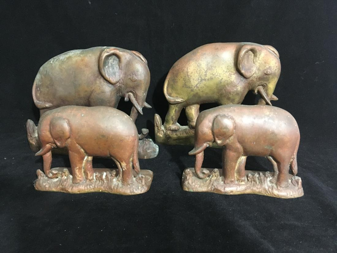 2 PAIRS OF HEAVY COPPER ELEPHANT BOOKENDS OR DOORSTOPS.