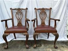 A PAIR OF CENTENIAL CHIPPENDALE MAHOGANY ARMCHAIRS