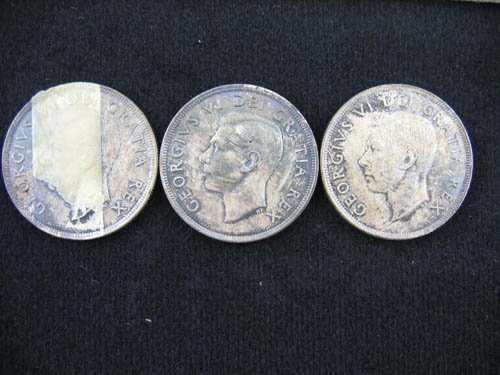 919103: SET OF 3 1949 CANADIAN SILVER DOLLARS