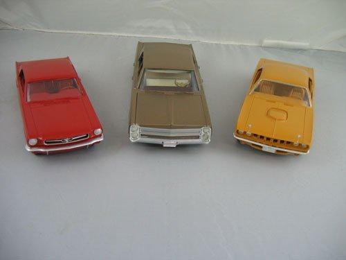 1119102: 3 DEALER PROMO CARS; VINTAGE RED FORD MUSTANG,