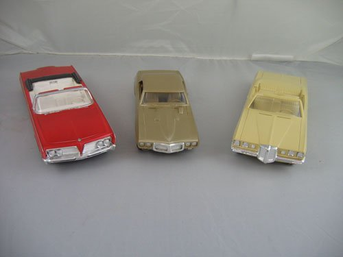 1119103: 3 DEALER PROMO CARS; 1964 RED IMPERIAL, 1970 T