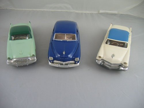 1119111: 3 DEALER PROMO CARS; 1956 CREAM AND BLUE CADIL