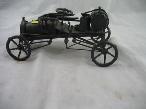 1217103: SIGNED FOLK ART IRON HOT ROD DESK TOP ART PIEC