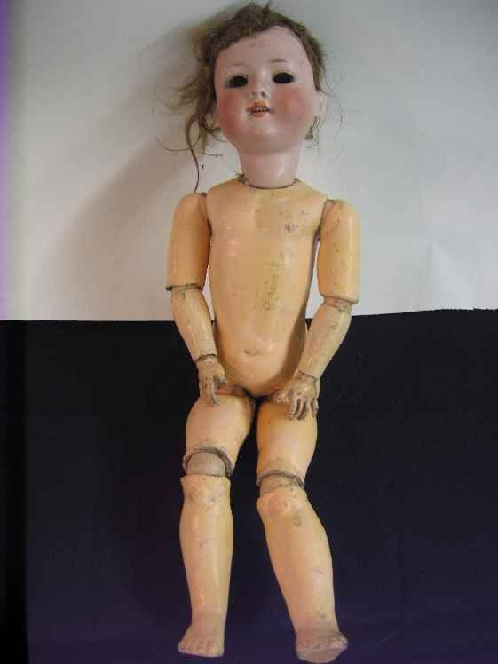 701110E: ARMANDE MARSEILLES PORCELAIN DOLL. JOINTED BOD