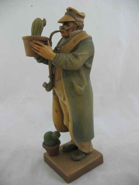 930114: ANRI FIGURE OF MAN WITH PIPE & CACTUS 9""