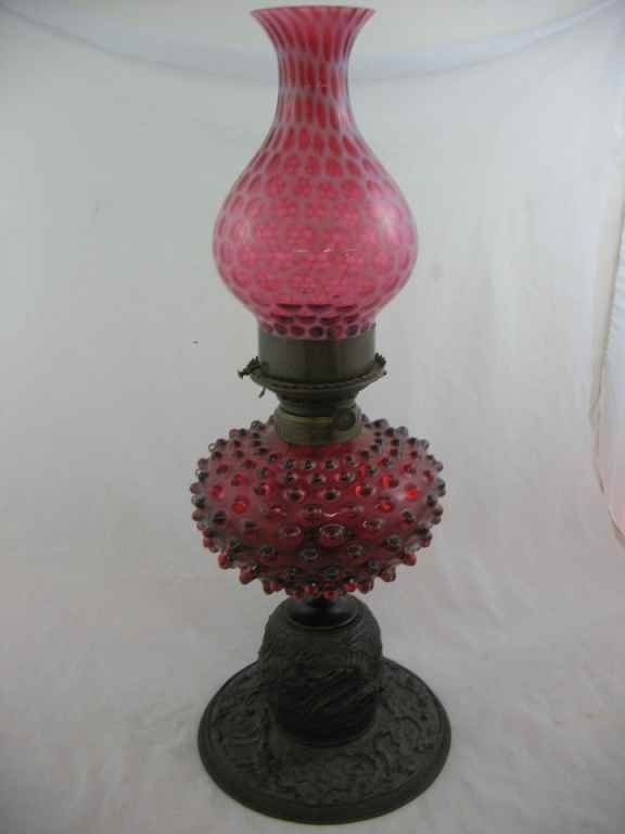 930120: BRONZE RELIEF DECORATED & RUBY HOBNAIL OIL LAMP