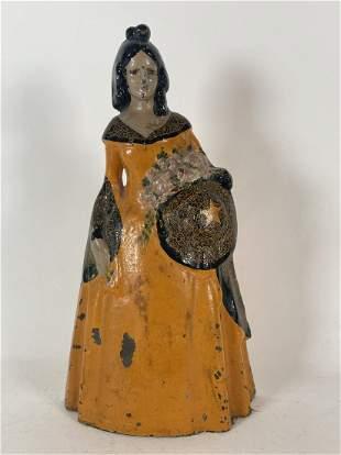 "A CAST IRON DOORSTOP OF A VICTORIAN WOMAN 12"" TALL X 6"""