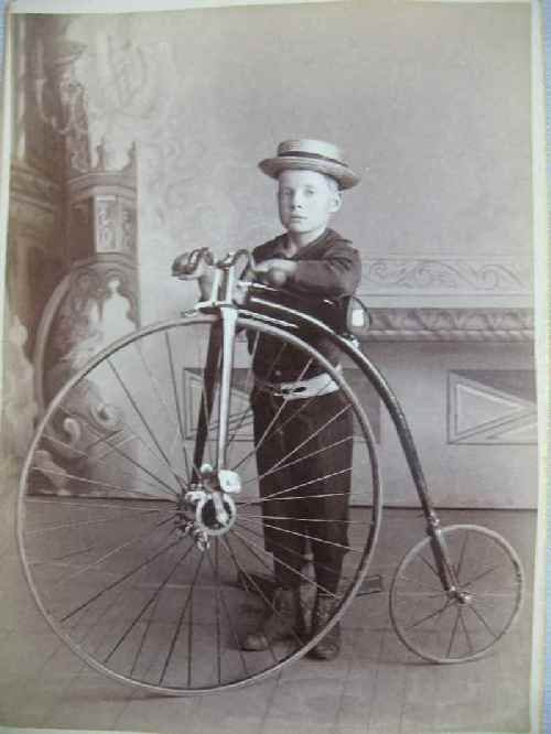 120134: CARD PHOTO OF A BOY WITH A HIGH WHEEL BICYCLE
