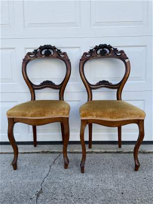 A PAIR OF FRENCH WALNUT BALLOON BACK CHAIRS WITH CARVED
