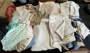 A BOX OF VINTAGE TABLE CLOTHES