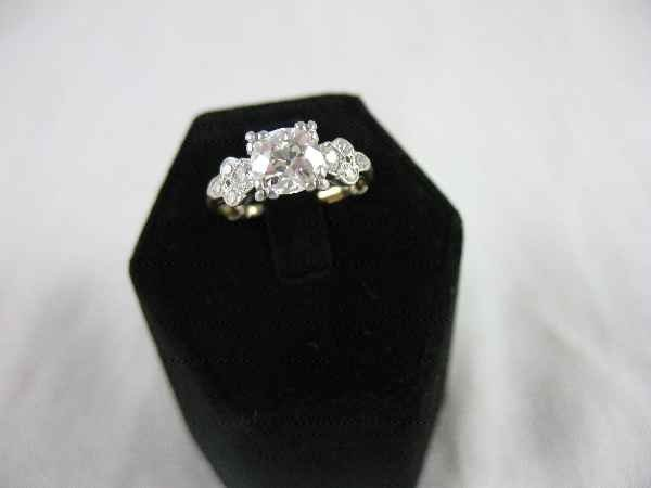 428002: PLATINUM AND 14K GOLD VINTAGE DIAMOND RING WITH