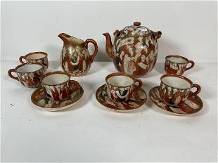 """A JAPANESE RED AND WHIT PORCELAIN TEA SERVICE. 7"""" AND"""