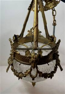 A LARGE VICTORIAN CRYSTAL AND BRONZE CHANDELIER