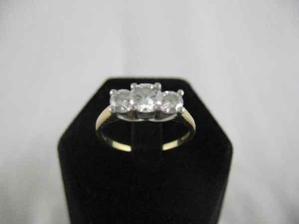 1211001C: 14K GOLD AND PLATINUM RING W/ 3 DIAMONDS