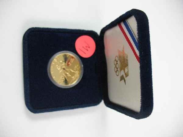 7270001W: 1/2 OZ 1984 OLYMPIC GOLD COIN