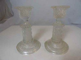 12210078: PAIR OF EARLY PRESSED GLASS CANDLESTICKS (POS