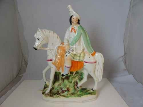 12210102: STAFFORDSHIRE FIGURE OF A HORSE & RIDER (14""
