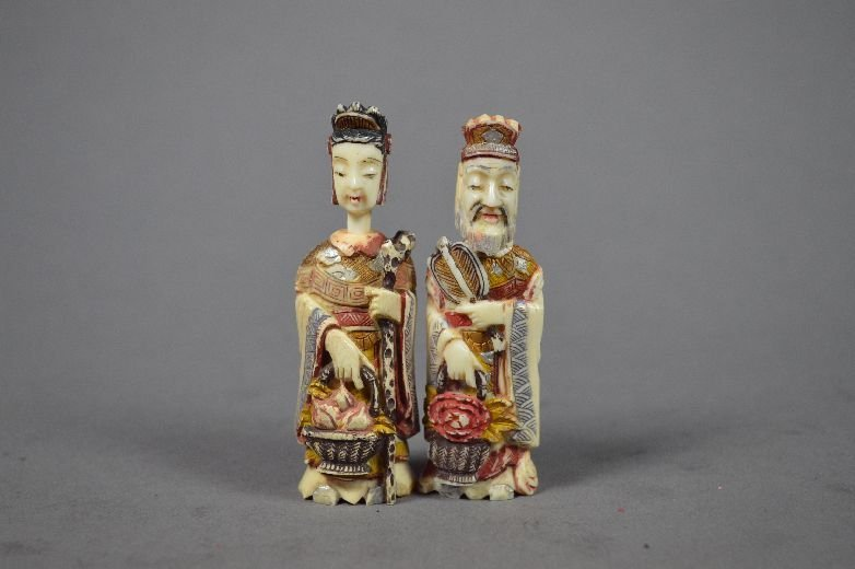 110005: A pair of carved multicolored ivory snuff bottl