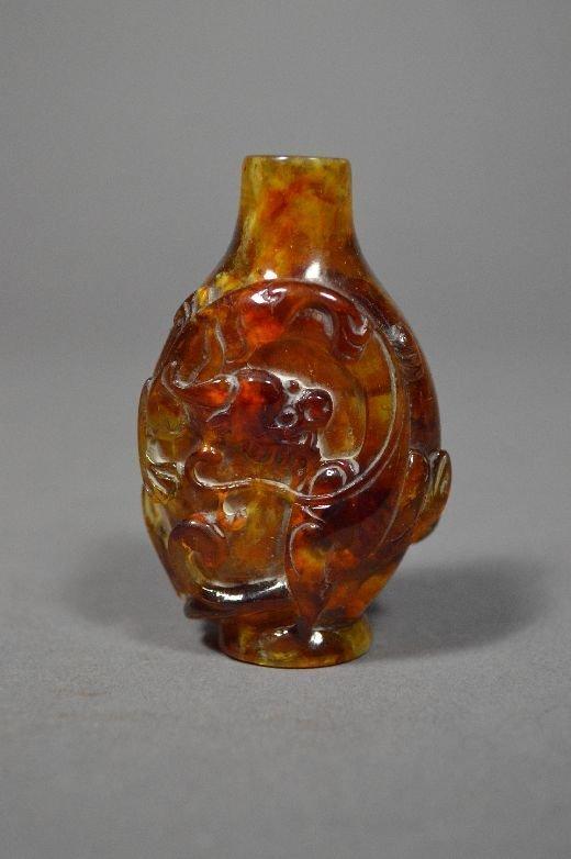 110010: Carved amber snuff bottle
