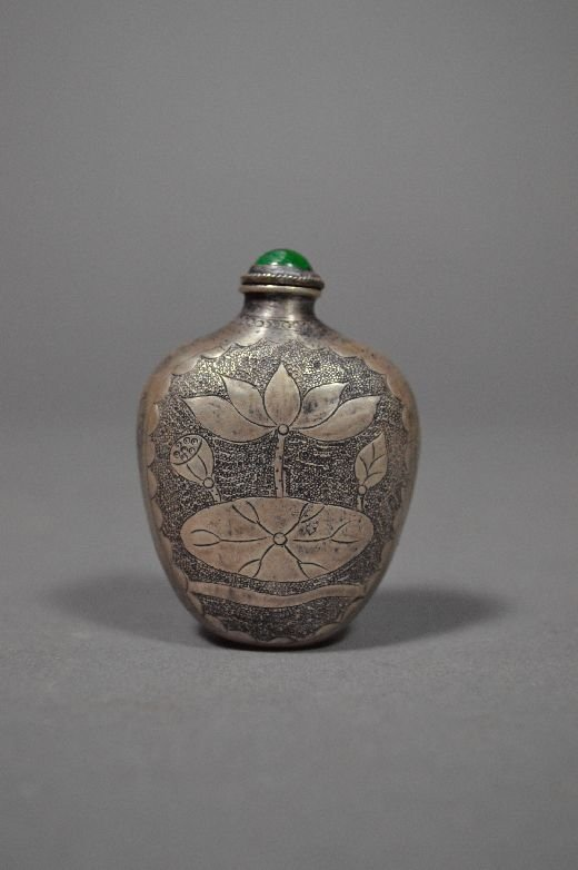 110014: Carved silver snuff bottle