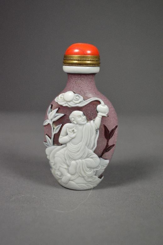 110021: Carved Peking glass snuff bottle