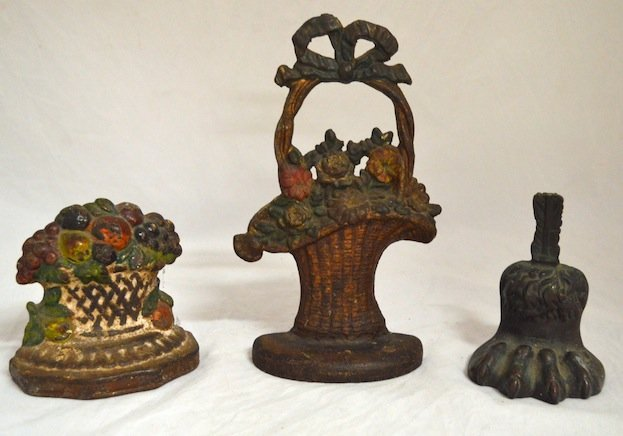3 19th C. Doorstops , 2 floral and a gryphon foot