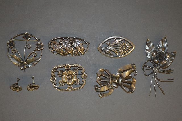 7 ANTIQUE STERLING SILVER REPOUSSE PINS,