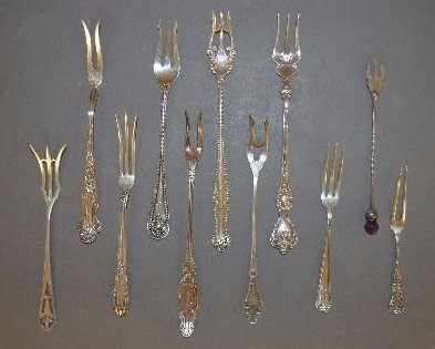 10 FANCY STERLING SILVER LEMON FORKS