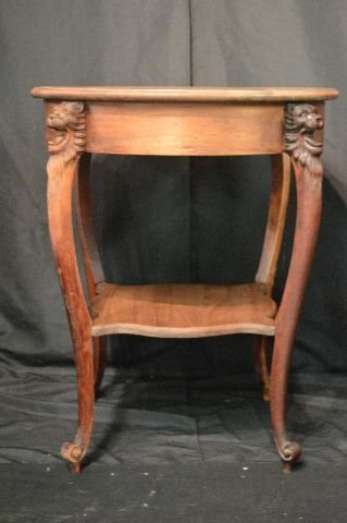 MAHOGANY LAMP TABLE WITH CARVED GRYPHON HEADS