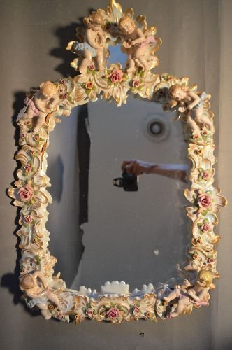LARGE PORCELAIN MIRROR FESTOONED WITH CHERUBS AND