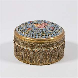 An Elfinware Jewelry box with porcelain flowers and