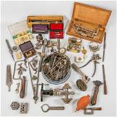 A collection of tools, lathe and small parts for a
