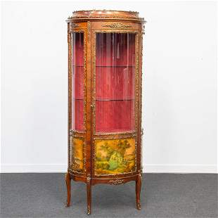 A Bronze mounted oval display cabinet, with romantic