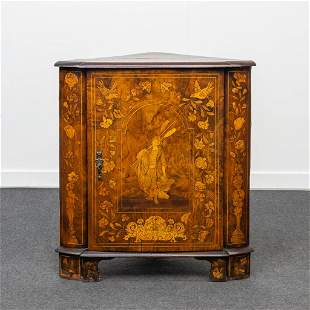 A marquetry inlaid corner cabinet with floral decor.