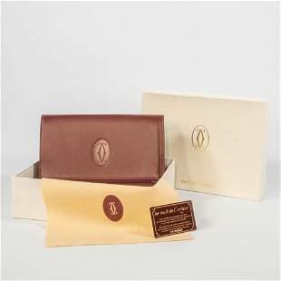 A Must De Cartier brown leather purse or handbag, New