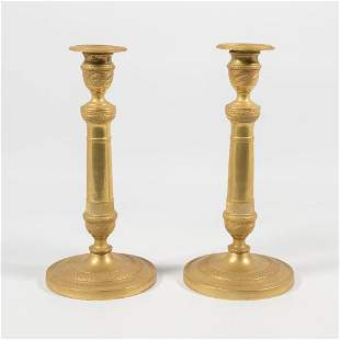 A pair of 19th century candlesticks and a bronze Louis