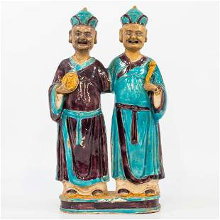 A statue made of glazed earthenware, a pair of Easern