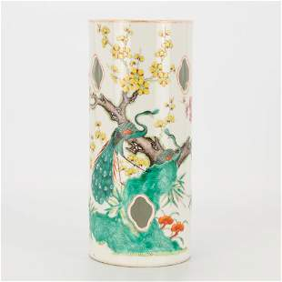 A Chinese porcelain hat stand with images of peacocks
