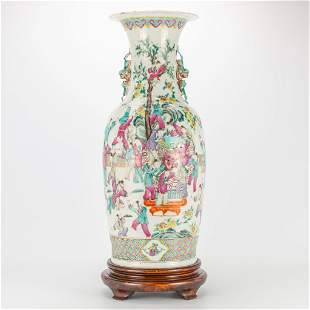 A Chinese porcelain vase with decor of playing
