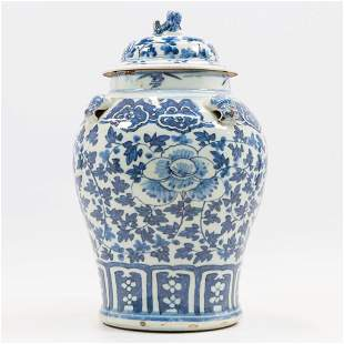 A blue and white Chinese vase with lid, decorated with