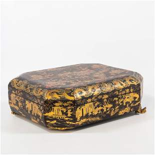 A Chinese lacquered storage box, with gold decor, on