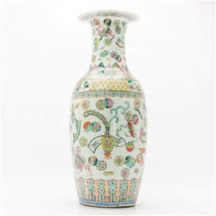 A Chinese vase with decor of symbols of happiness.