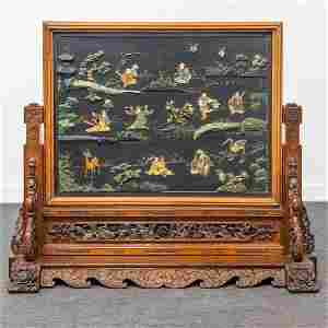 A Chinese sculptured table screen with images of the 8