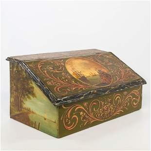An antique writing box with a hand-painted decor with a