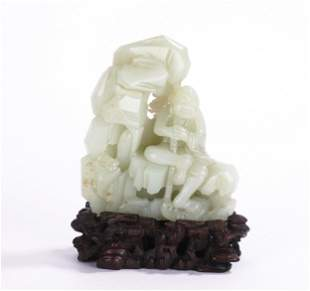 A CHINESE WHITE JADE CARVED ARHAT DECORATION